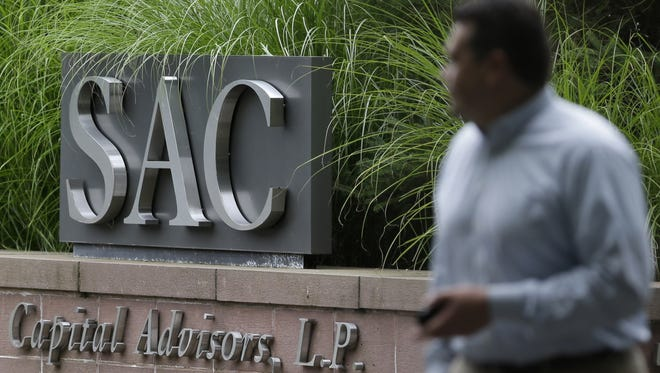A sign is displayed in front of SAC Capital Advisors headquarters in Stamford, Conn. The hedge fund operated by embattled billionaire Steven A. Cohen was hit with white-collar criminal charges Thursday that accused the fund of making hundreds of millions of dollars illegally, and a related government lawsuit said insider trading was pervasive and unprecedented at the firm.