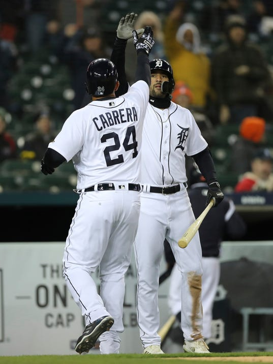 Detroit Tigers' Miguel Cabrera is congratulated by Nicholas Castellanos after hitting a solo home run during the sixth inning of game two of a baseball doubleheader against the Pittsburgh Pirates, Sunday, April 1, 2018, in Detroit. (AP Photo/Carlos Osorio)