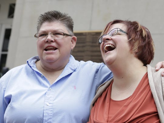 Jayne Rowse, left, and her partner, April DeBoer, make