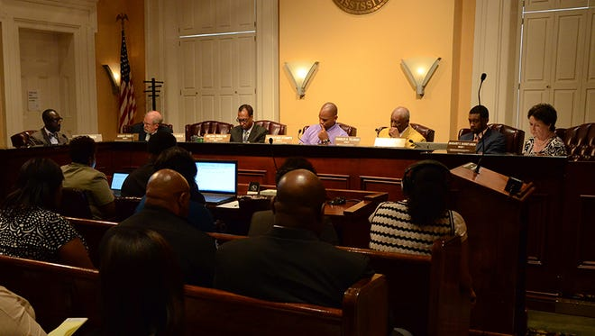 Jackson Mayor Tony Yarber (left) speaks at a budget hearing in the city council chambers Monday, August 10, 2015.