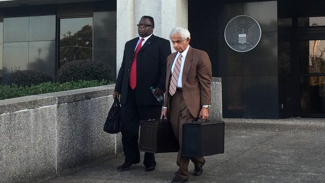 Forrest County Sheriff's Chief Deputy Charles Bolton and his attorney, Joe Sam Owen, leave the William M. Colmer Federal Courthouse.