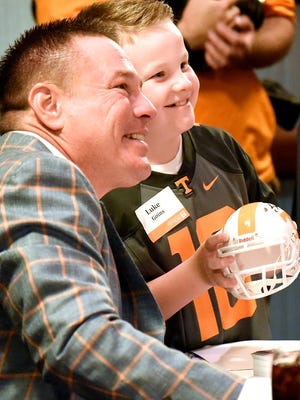 Tennessee football coach Butch Jones poses with Luke Goins during a previous Big Orange Caravan stop in Chattanooga.