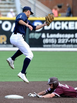 <p>Vanderbilt's Vince Conde (3) tries to make an out while Texas  A&M's Krey Bratsen (13) slides into second base Sunday. Bratsen was safe.</p>