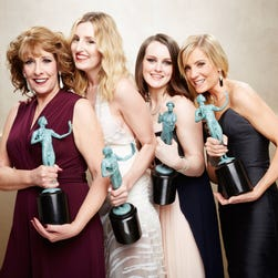 The cast of Downton Abbey after SAG win on Jan. 25, in Los Angeles. Phyllis Logan, Laura Carmichael, Sophie McShera, Joanne Froggart.
