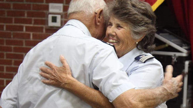 Irvin hugs D'Agostino. D'Agostino was patrolling the Gulf and Caloosahatchee until three years ago.