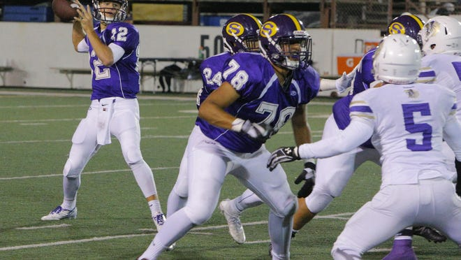 FILE: The Salinas line, including Julio Cardona (78), protects quarterback Brett Reade, who throws a pass during the first half of Friday's game at The Pit.