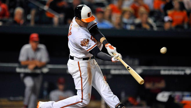 Baltimore Orioles third baseman Manny Machado (13) hits the game winning solo home run in the twelfth inning against the Los Angeles Angels at Oriole Park at Camden Yards.
