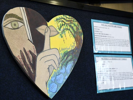 """Survivor artwork titled """"Not All Wounds Are Visible"""" is displayed at the Corizon Lastimado: Healing the Wounded Heart art exhibit."""