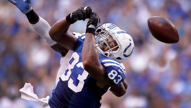 Indianapolis Colts tight end Dwayne Allen (83) watches as the football slips through his hand in the second half of their game Sunday, September 11, 2016, afternoon at Lucas Oil Stadium. The Colts lost to the Lions 39-35.