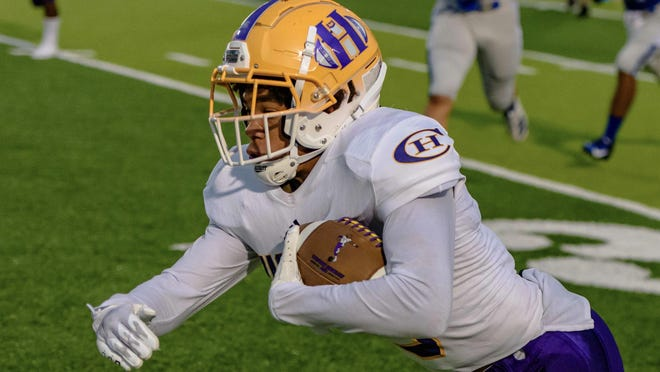 Hickman's Devin Turner (3) carries the ball during a game against Capital City on Sept. 11 in Jefferson City.