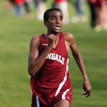 Aidan Reed of Helena High runs in a cross-country meet this past September. He is a top distance runner on the track for the Bengals.