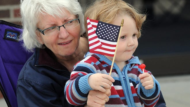 Connor Weston sits with his grandmother, Ruth Habalewski, during the Memorial Day Parade in Port Huron.