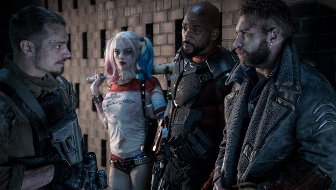Joel Kinnaman (from left), Margot Robbie, Will Smith and Jai Courtney star in 'Suicide Squad.'