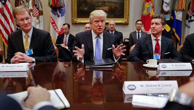 President Donald Trump speaks while hosting a breakfast with business leaders in the Roosevelt Room of the White House in Washington, Monday, Jan. 23, 2017. Left, Wendell P. Weeks, Chief Executive Officer of Corning, Alex Gorsky Chairman and Chief Executive Officer of Johnson & Johnson.