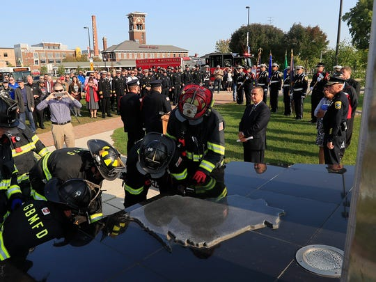 Green Bay firefighters remove parts of the 9/11 memorial