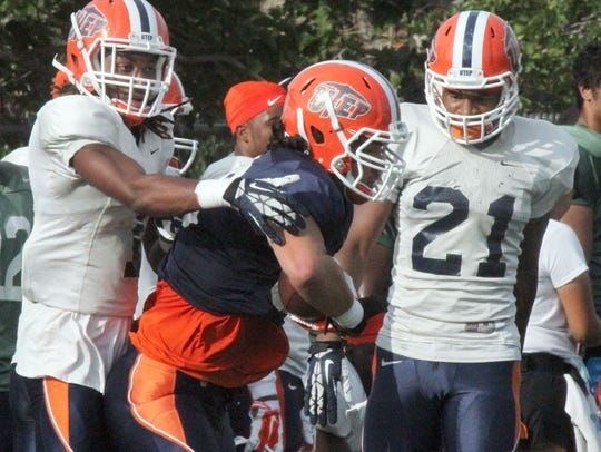 UTEP defensive backs Kalon Beverly, left, and Dashone