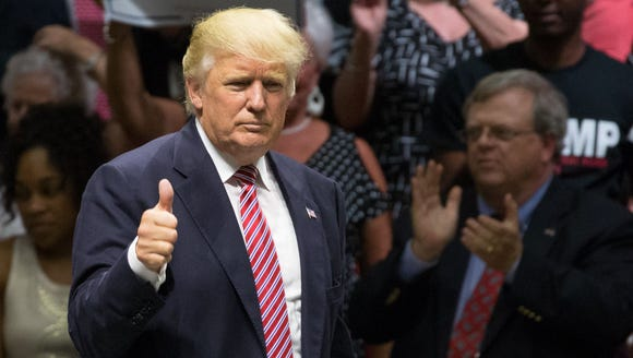 Donald Trump gives a thumbs-up following his speech