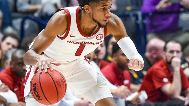Razorback guard Isaiah Joe from Fort Smith takes care of the ball against Vanderbilt on March 11, 2020 at the SEC Tournament in Nashville.