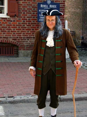 David Gardellin portrays   Ben Franklin outside the historic Revell House at a past Wood Street Fair in the Colonial city of Burlington. This year' fs air is Saturday.