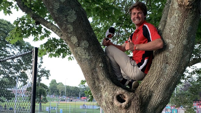 Orleans Firebirds intern Scotty Gange hides in a tree at Eldredge Park during a 2019 Cape Cod Baseball League game. Gange, a 2020 Arizona State University graduate, was recently named the top college sports broadcaster in the nation.