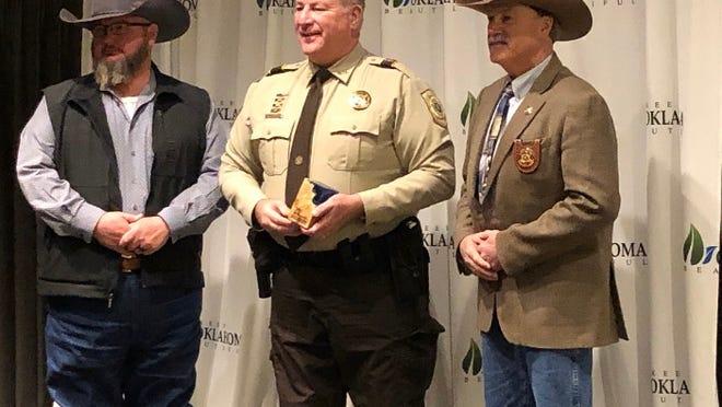 Environmental Crimes Deputy Shaun Copelin winning his awards at Keep Oklahoma Beautiful's 29th Annual Environmental Excellence Celebration.