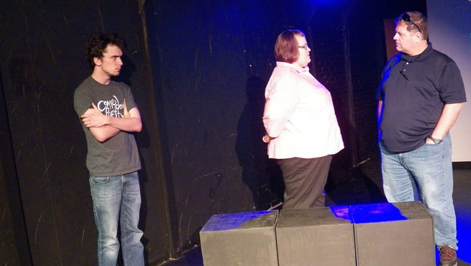 """Cody Dunstan, Cara Baque and Paul David are shown in a scene from the Cody Daigle-Orians original play, """"Why We Fall."""""""
