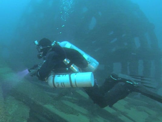 Marty Lutz of Warren explores the wreckage of the Keystone State in the deep waters of Lake Huron. Two 40-foot-tall