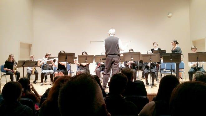 LSMSA chorale and mixed ensemble members perform at holiday concert.