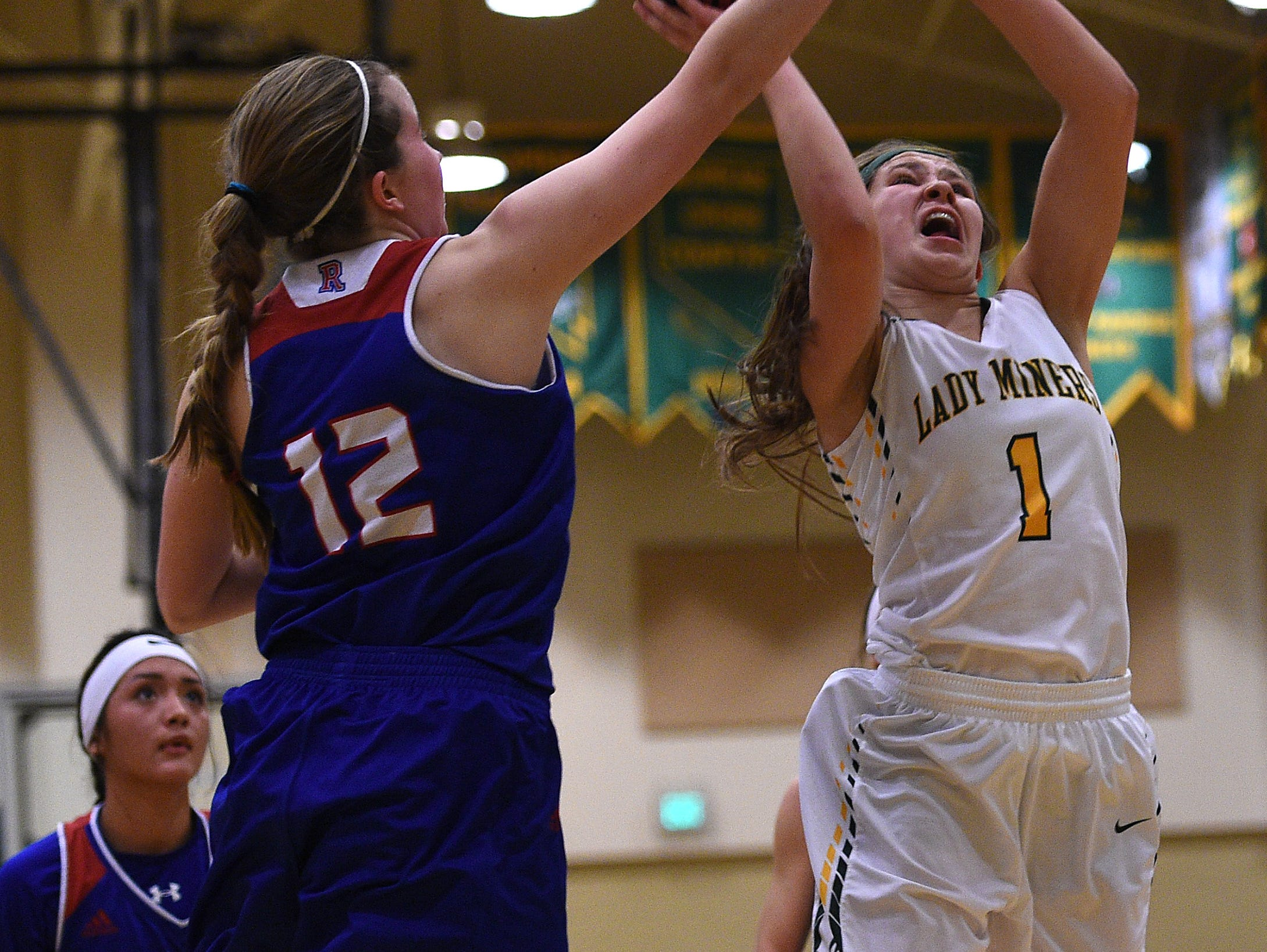 Bishop Manogue's Katie Turner (1) drives against Reno's Mia Wilmot (12) during their basketball game at Manogue on Friday