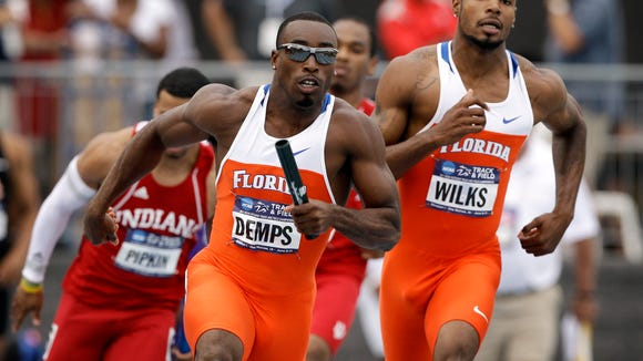 FILE -- Florida's Jeff Demps runs to the finish line after taking the baton during their 4 x 100-meter relay at NCAA outdoor track and field championships, June 8, 2011.