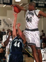 Huntington's Robert Green (#44) gets up to block Airline's