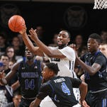 Bulldogs forward Roosevelt Jones makes a pass while guarded by Seton Hall's Angel Delgado during last year's meeting, Jan. 25.