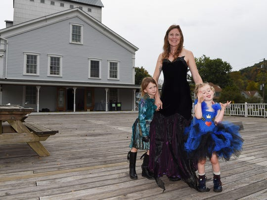 Bowie Barnett-Zunino poses with her kids Gilvey, 5, left, and Fenner, 3, right, outside of The Wassaic Project in Wassaic.