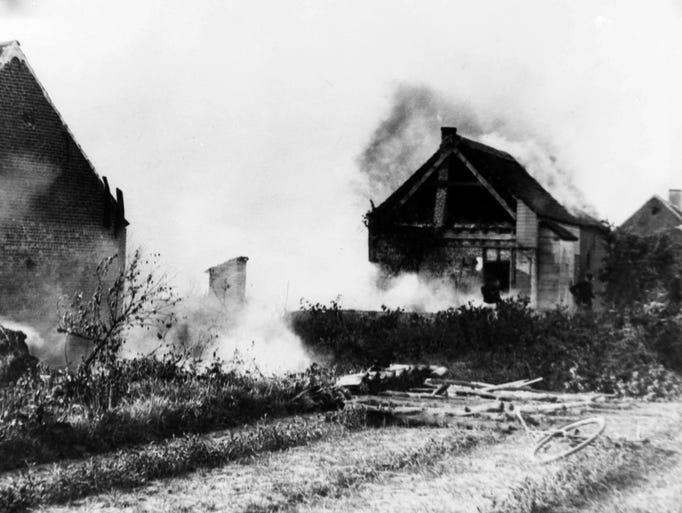 Cottages on the south bank of the Nethe River in Flanders burn during the Great War, date unknown. (AP Photo)