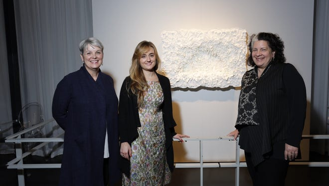 "Philadelphia-based glass artist Amber Cowan, center, unveiled her Rakow Commission piece ""Garden of the Forgotten and Extinct"" at the Corning Museum of Glass on Thursday evening. At left is Karol Wight, museum executive director, and Tina Oldknow, senior curator of modern and contemporary glass."