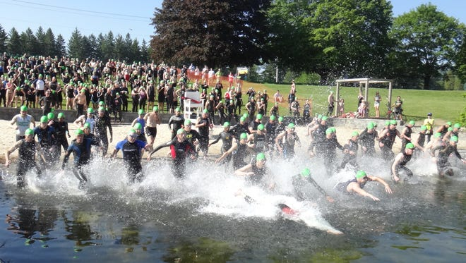 Athletes begin the swimming portion of the 2013 Pawling Triathlon. This year's event will be held on June 7.