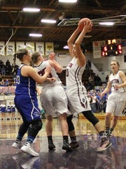 Dayton's Kalina Rojas (10) grabs a rebound against Amity at the OSAA Class 3A state basketball tournament at Marshfield High School in Coos Bay on Saturday, March 6, 2016.