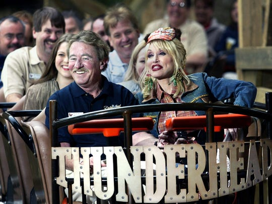 Dolly Parton takes the first ride, albeit a short one, in her new wooden roller coaster Thunderhead on April 6, 2004, at Dollywood.