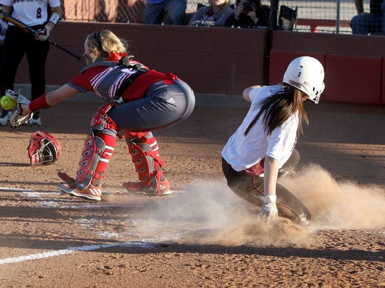 Bowie's Henslee Ogle slides into home behind Holliday's Landri Allen Tuesday, March 7, 2017, in Holliday.