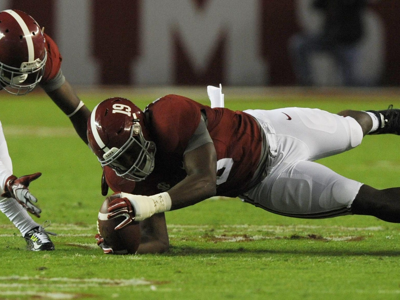Alabama linebacker Reggie Ragland dives on a fumble early in the first quarter against Auburn in the Iron Bowl at Bryant-Denny Stadium in Tuscaloosa last year.