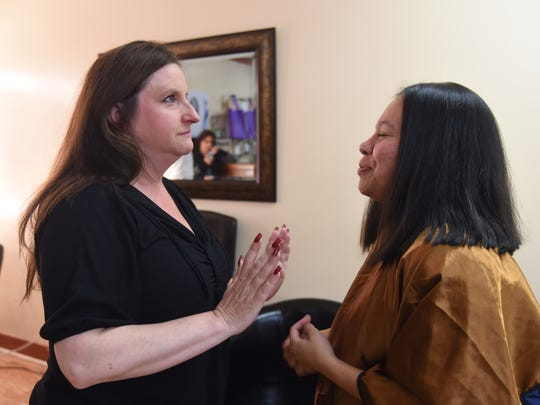 From left, Kim Ross, and Erika Hernandez pause after Hernandez had 26 inches of her hair cut off at An'Tyrice Salon in the City of Poughkeepsie on Saturday. Ross was recently diagnosed with breast cancer, and Hernandez generously offered to donate her hair to create a wig for Ross.