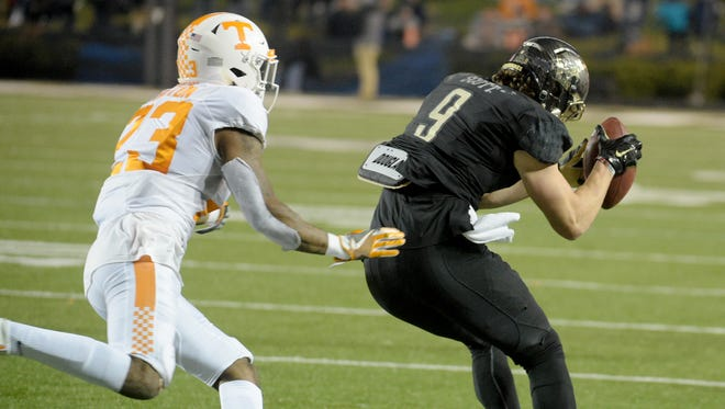 Vanderbilt wide receiver Caleb Scott (9) catches a pass before being pushed out of bounds by Tennessee defensive back Cameron Sutton (23) in the second half of the game between Vanderbilt and Tennessee at Vanderbilt Stadium Saturday, Nov. 26, 2016, in Nashville, Tenn.