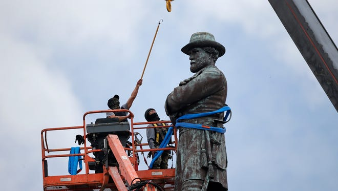 In this May 19, 2017, file photo, workers prepare to take down the statue of former Confederate general Robert E. Lee, which stands over 100 feet tall, in Lee Circle in New Orleans. Hanceville Mayor Kenneth Nail wrote to New Orleans Mayor Mitch Landrieu, asking him and city leaders to consider donating Confederate monuments recently removed from their pedestals in New Orleans to his town so they could be displayed in Veterans Memorial Park in Hanceville, Ala. Landrieu's office didn't immediately respond Monday, June 19, to an emailed request for comment. (AP Photo/Gerald Herbert, File)