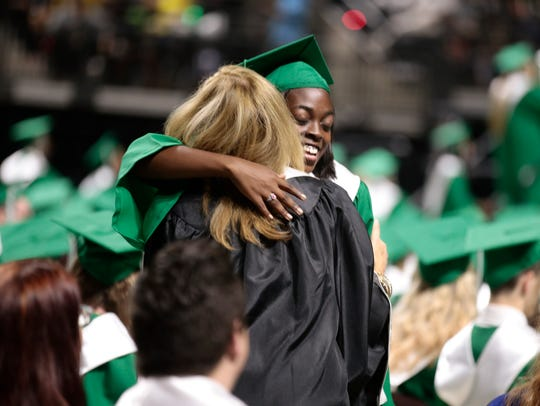 Graduate Halle Taylor gets a hug from teacher Aline