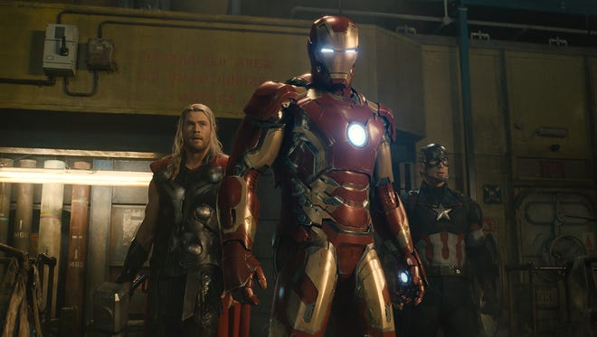 Thor (Chris Hemsworth), Iron Man (Robert Downey Jr.) and Captain America (Chris Evans) face off with a killer robot in 'Avengers: Age of Ultron.'