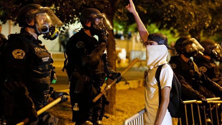 Riot police block off the Albuquerque Convention Center