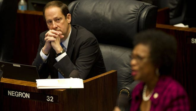 Florida Sen. Joe Negron, R-Stuart, attended a Florida Senate session on Jan. 13 at the Florida Senate in Tallahassee during the 2016 Florida legislative session. In August, Negron announced his plan to divert and store water south of Lake Okeechobee. It requires buying 60,000 acres of mostly sugar land and building a reservoir to hold 120 billion gallons of water.