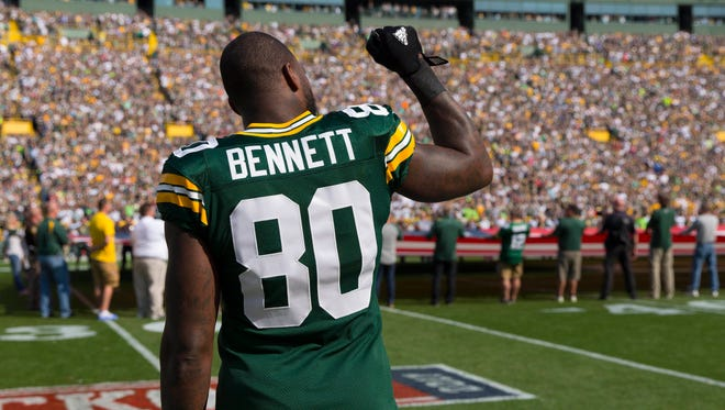 Green Bay Packers tight end Martellus Bennett (80) holds his fist in the air during the national anthem prior to the game against the Seattle Seahawks at Lambeau Field.