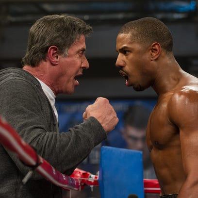 Rocky Balboa (Sylvester Stallone, left) is back in