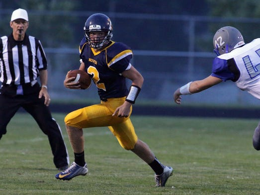 Sheboygan North's Bailey Meyer (2) carries the ball against Green Bay Southwest Friday August 29, 2014 at North.